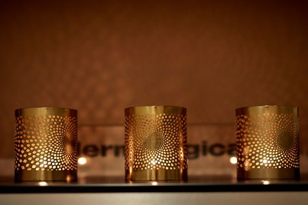 Candles with Dermalogica logo in background