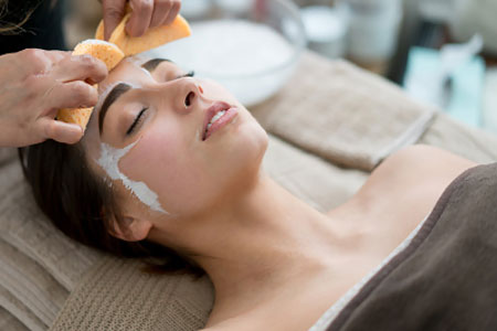 Jan Marini Facials - Woman getting a facial at the spa