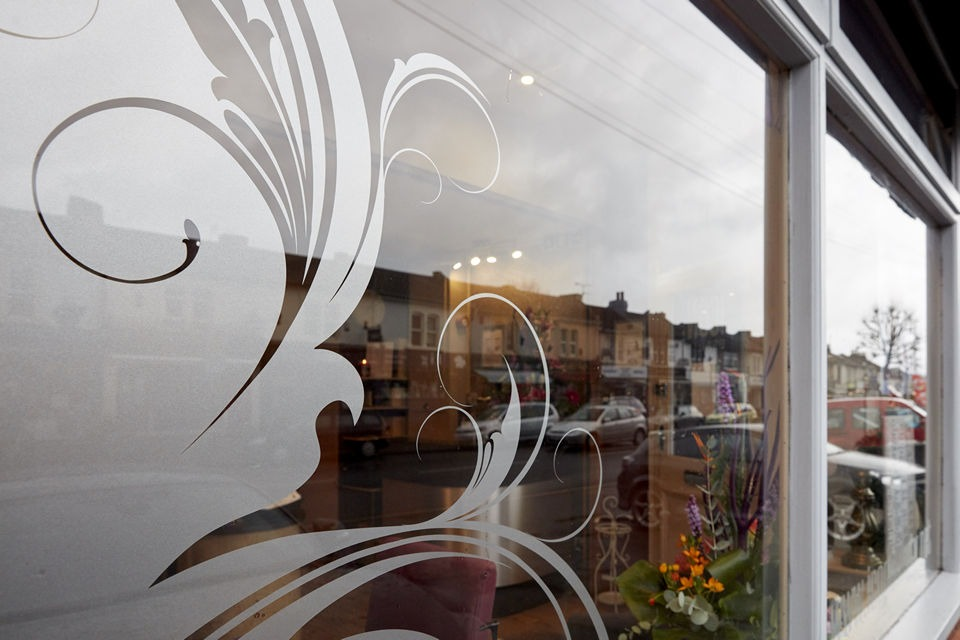 Salon front window with swirls
