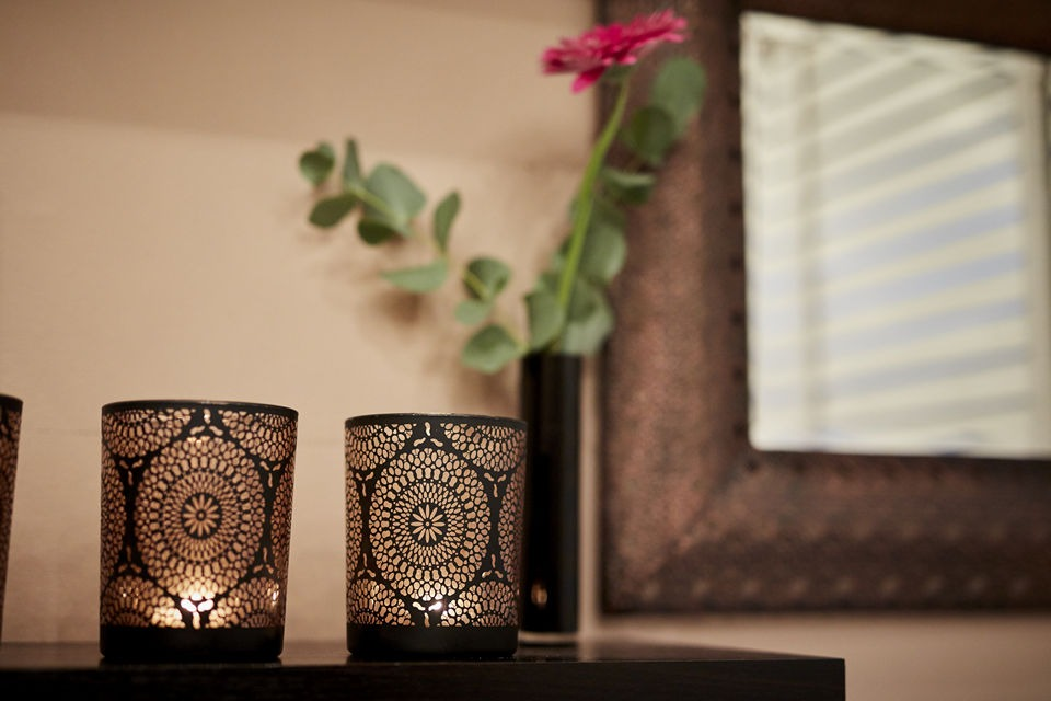 Candles, flower and mirror